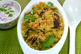 stock photo of raita  - Vegetable biriyani served with raita - JPG