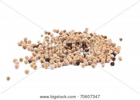 Heap of white spicy peppercorn.