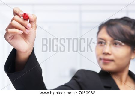 Asian Businesswoman Drawing With Red Felt Tip Pen