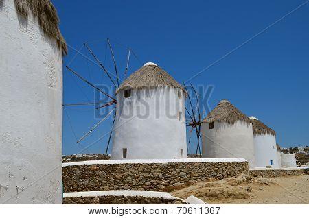 White windmills on the island of Mykonos. Greece