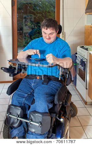 Spastic Young Man Confined To A Wheelchair