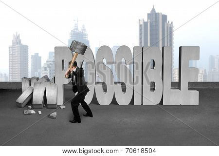 Businessman Hold Sledgehammer To Smash Impossible 3D Concrete Word