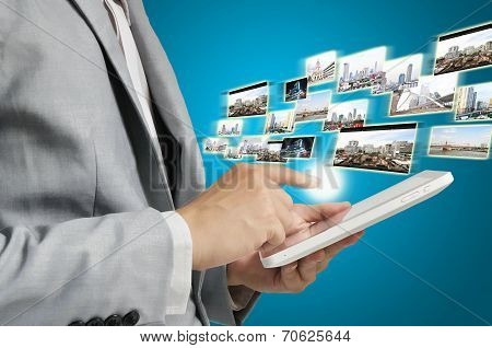 Business Man Holding Tablet Sending Or Receiving Streaming Images