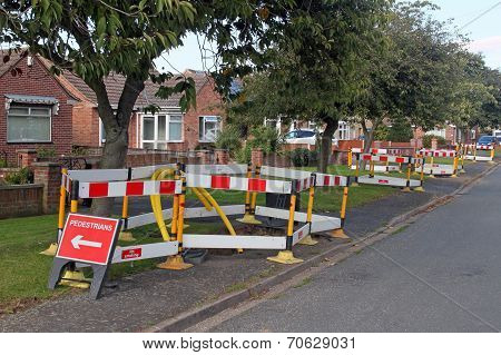 Road Work Warning Signs And Barriers In A Street In England.