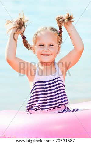happy laughing girl holds pigtails. toned image