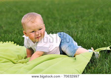 Little Boy On Green Blanket