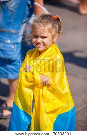 ODESSA, UKRAINE - August 23: Flash mob in city of Odessa on Potemkin Stairs on August 23, 2014, in day of a national flag of Ukraine. Happy participants kids of summer Flash mob with a flag