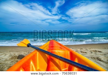 Kayak Looking At The Beach And Ocean Waves