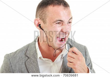 Angry Man With Earbuds Connected On Mobile Phone Yelling