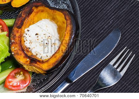 Acorn squash with sour cream and salad.