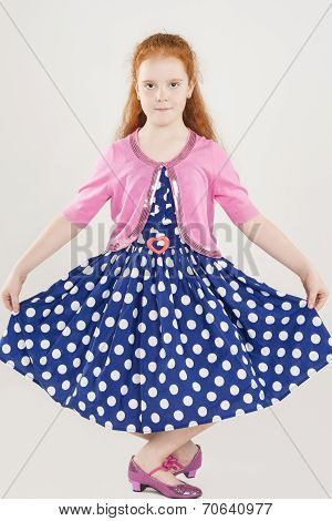 Pretty And Artistic Caucasian Redhaired Girl Posing In Polkadotted Dress