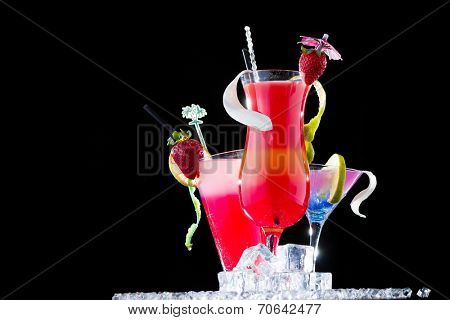 Fresh tropical strawberry cocktail on black background