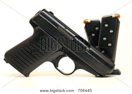 Semi Auto Handgun And Magazines