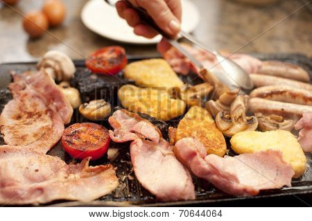 Man Serving A Hearty Cooked Breakfast