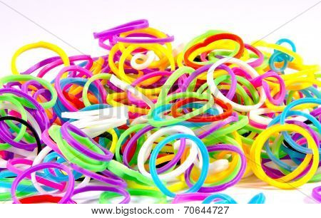 elastic loom bands color full on white background .