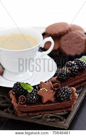 Chocolate ganache tart with blackberries