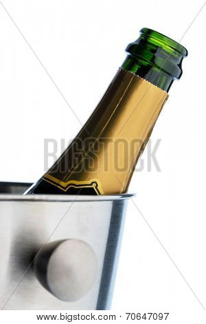 a bottle of champagne in a champagne bucket. champagne in champagne bucket