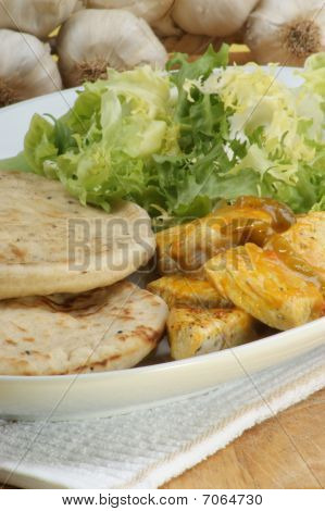 Naan Bread With Turkey Curry On A Plate