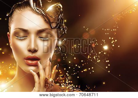 Model Girl face with gold skin, nails, make-up and accessories.