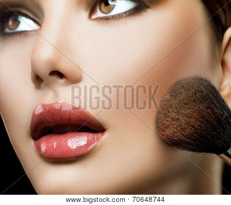 Makeup. Make-up Face. Big Make up brush. Makeup applying concept. Beautiful fashion model girl face closeup.