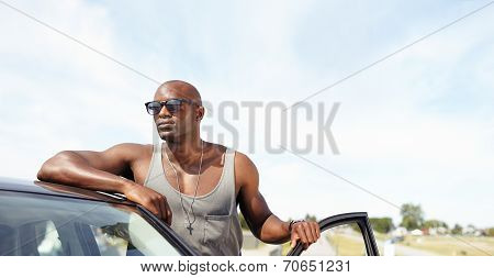 Handsome Young Guy With A Car Looking Away