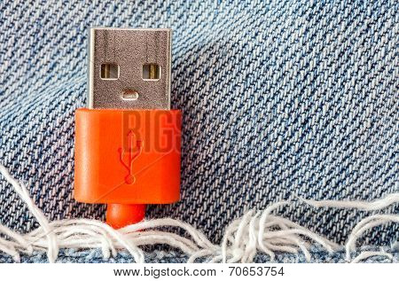 Close-up The Red Usb Cable In Jeans Pocket