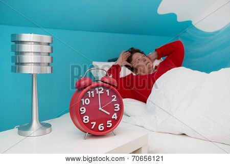 Senior Woman In Bed Ill And Suffered Of Sleeplessness Or Insomnia.