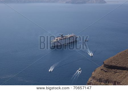 Cruise Ship Off The Coast Of Santorini. Santorini - One Of The Most Visited Places In Greece