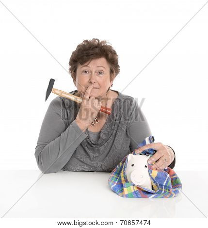Isolated Senior Woman - Money Concept With A Pensioner. Smashing Piggy Bank.