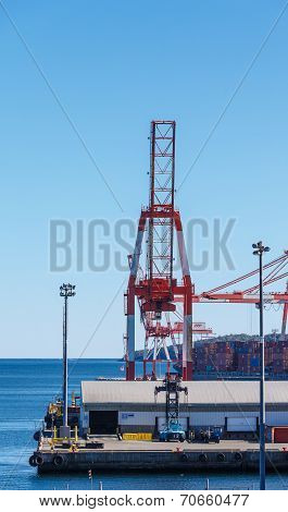 Shipping Crane On Industrial Port