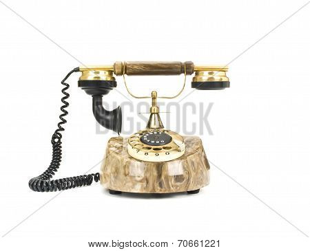 Old telephone on white backgound