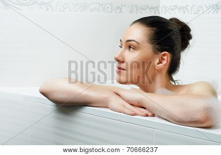 beautiful girl lying in the bathroom