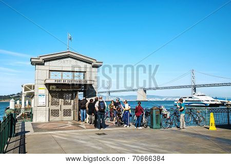 Tourists Waiting For To Hop On The Boat At A Gate In San Francisco