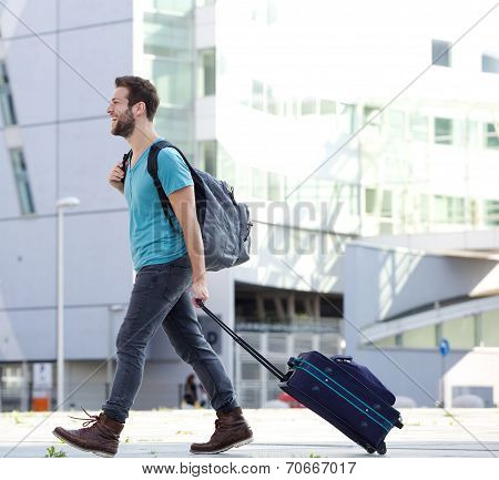Young Man Traveling With Suitcase And Bag