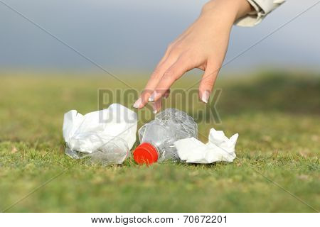 Woman Hand Collecting Garbage In The Mountain