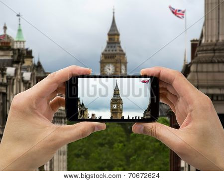 Tourist Holds Up Camera Mobile At Big Ben In Flag