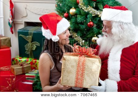 Santa Claus Giving A Present