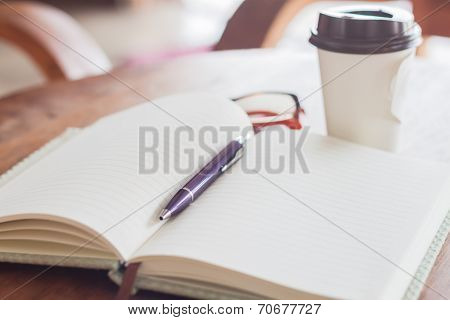 Notebook And Pen With Coffee Cup