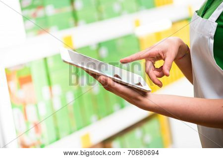 Sales Clerk Using Tablet