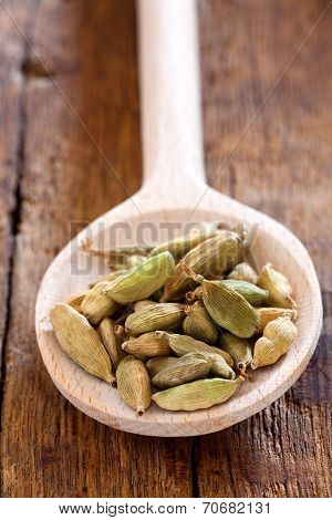 Wooden Spoon With Green Cardamom Pods