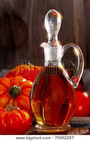 Fresh Meat Tomatoes And A Carafe Of Olive Oil