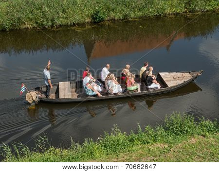 Tourist In An Boat With Guide