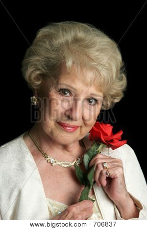 Beautiful Senior Lady With Rose