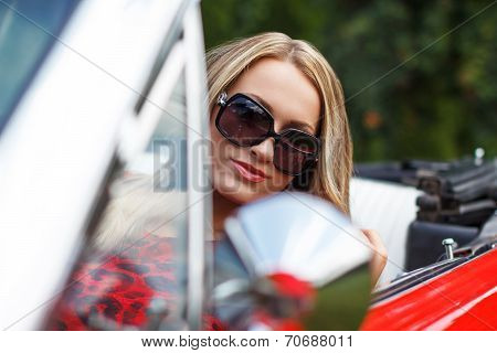 Blonde Lady In Red Cabriolet