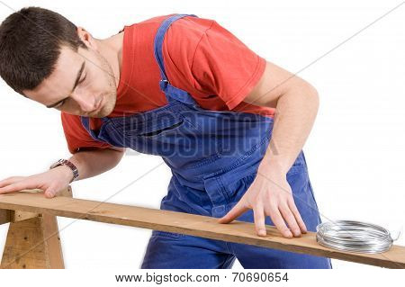 Carpenter And Wooden Board