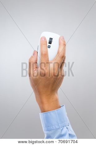 Businessman hand holding computer mouse