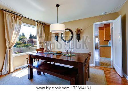 Warm Dining Room With Massive Wood Table