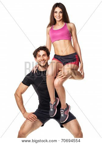 Sports Guy Holds On Shoulder A Girl On A White Background