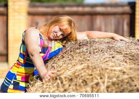 Woman Near A Haystack