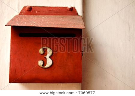 Red Letterbox On Cream Wall, Number Three